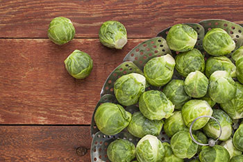 Glucosinolate, a natural component of Brussels sprouts and other vegetables in the cruciferous family, has been associated with a decreased risk of cancer, including lung, stomach, and colon cancers.