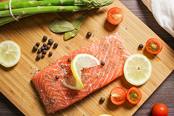 Pacific salmon varieties most commonly found in grocery stores include king, sockeye, coho, pink, and chum.