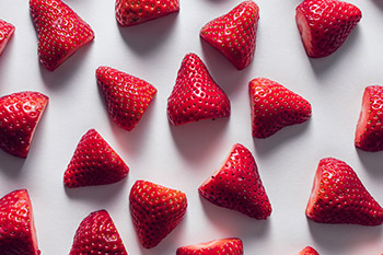 Strawberries are an excellent source of vitamin C and manganese and a good source of fiber. Strawberries also contain antioxidant flavonoids. In research, flavonoids have demonstrated protective effects against chronic diseases such as cardiovascular disease due to their anti-inflammatory, anti-diabetic, anti-cancer, and neuroprotective qualities.